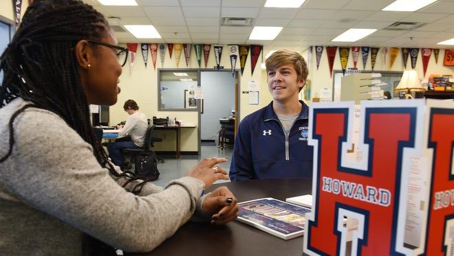 Centennial High School student Jack Crouch talks with Howard University representative Krystal Johnson at Centennial in Franklin.