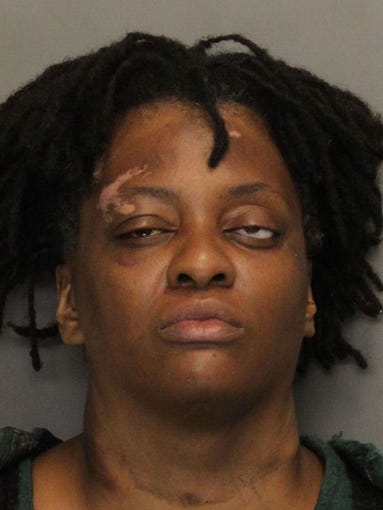 Emmerli Wilcoxson is charged with stealing a police car and leading authorities on a high speed chase on the Downtown Connector