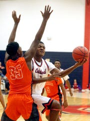 Oakland's Tre Jones (1) goes up for a shot as Blackman's Brandon Thomas (35) guards him on Tuesday, Jan. 31, 2017.