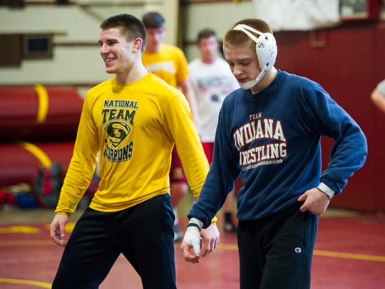 Mater Dei wrestlers Joe Lee, left, and his brother, Matt Lee, during practice at Mater Dei, Thursday, Feb. 9, 2017.