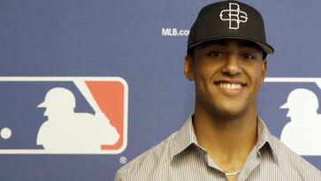 Amateur baseball player Garrett Whitley poses for a photo after a media luncheon for Major League Baseball's Draft, Monday, June 8, 2015, in New York. (AP Photo/Mary Altaffer)
