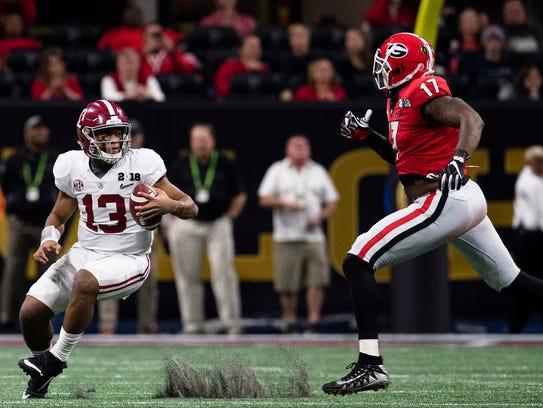 Alabama quarterback Tua Tagovailoa (13) runs away from