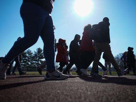 Students at Brandywine High School walk around the