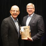 Greer CPW General Manager Jeff Tuttle, right, receives SOAR recognition from APGA President and CEO Bert Kalisch.