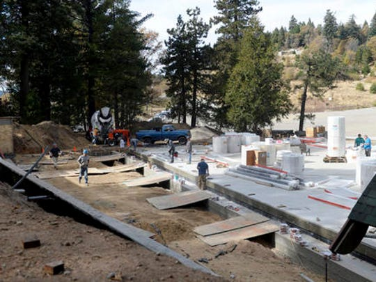 In this Tuesday, Nov. 15, 2016, photo, construction crews work on building the Silver Bells Skating Pond at the new Skypark at Santa's Village in Skyforest, Calif. Developers have been planning to convert the Christmas-themed 153-acre-park, which has been closed since 1998, into a year-around, action-oriented destination, with mountain biking, fly-fishing, archery, a climbing wall and a zipline.