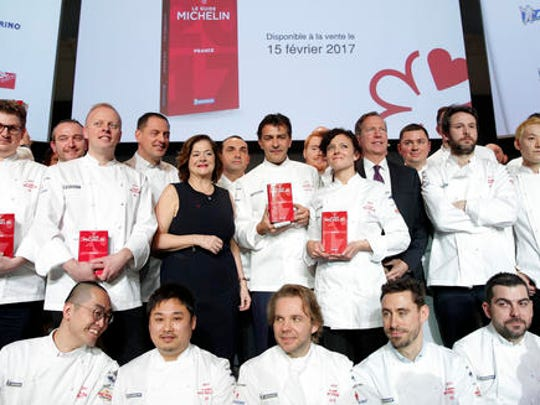 French chef Yannick Alleno who runs Le 1947 restaurant in Courchevel, center, awarded three stars from the Michelin guide, poses with one and two stars chefs, in Paris Thursday, Feb.9, 2017. One restaurant was newly awarded with the prestigious 3 stars this year.