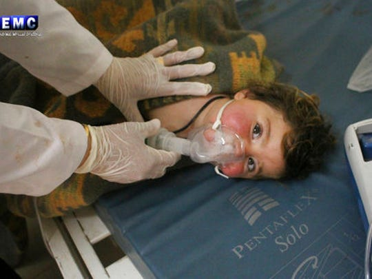 This photo provided Tuesday, April 4, 2017 by the Syrian anti-government activist group Edlib Media Center, which has been authenticated based on its contents and other AP reporting, shows a Syrian doctor treating a child following a suspected chemical attack, at a makeshift hospital, in the town of Khan Sheikhoun, northern Idlib province, Syria. The suspected chemical attack killed dozens of people on Tuesday, Syrian opposition activists said, describing the attack as among the worst in the country's six-year civil war.