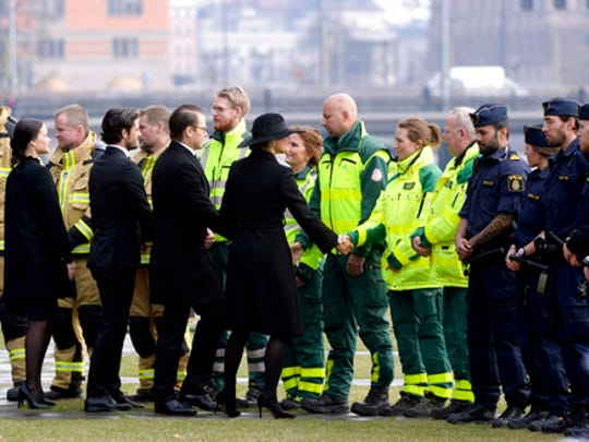Sweden's Crown Princess Victoria, right, Prince Daniel, second right, Prince Carl Philip and Princess Sofia greet emergency service workers during a ceremony at Stockholm City Hall, Monday, April 10, 2017, to honor the four killed victims and 15 injured in a fatal truck attack. The attack was allegedly carried out by an asylum-seeker from Uzbekistan who drove the stolen vehicle into a crowd of shoppers on a busy Friday afternoon in downtown Stockholm.