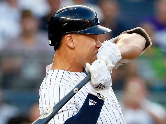 Jul 26, 2018; Bronx, NY, USA; New York Yankees designated hitter Aaron Judge (99) reacts to being hit by a pitch against the Kansas City Royals during the first inning at Yankee Stadium.