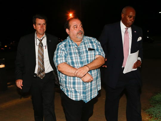 Anthony Mallia, Ramapo's chief building inspector, being led into Ramapo Town Court in Airmont on Sept. 15.