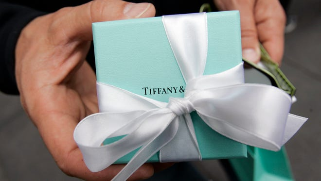A customer holds a gift he purchased at Tiffany & Co. in San Francisco.