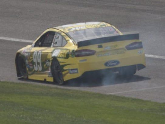 3-24-2014 carl edwards blown tire
