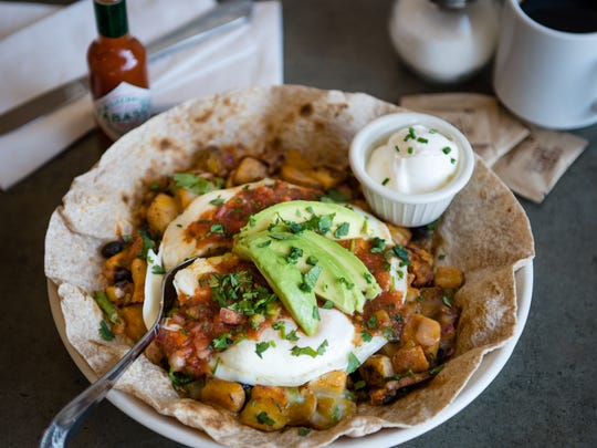 Huevos rancheros at Turning Point include diced potatoes, chipotle peppers, chorizo, onions, black beans, avocado and cilantro topped with three eggs in a toasted tortilla.