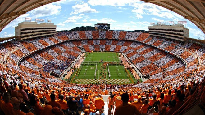 """Fans checker the Neyland Stadium as players run through the """"Power T"""" before a game in Knoxville, Tenn. (ADAM LAU/NEWS SENTINEL)"""