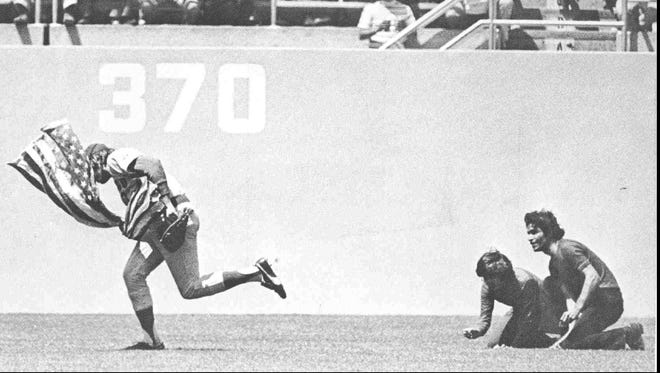 Rick Monday, then with the Chicago Cubs, salvaged an American flag from protesters in 1976.