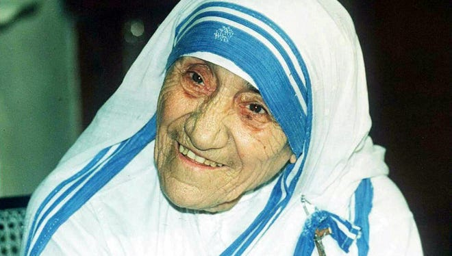 In this file photo taken April 12, 1995, Mother Teresa smiles for photographers in Calcutta.