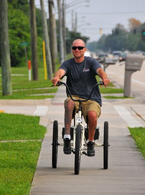 Mike Conneen was injured in an accident and became a paraplegic. Conneen, who can push but not lift with his legs, will participate in Cycle Jam for the Kids on Sunday April 25th, riding in the 10 mile family fun ride.