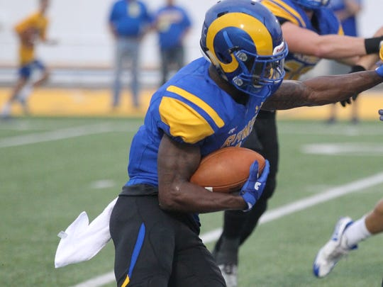 Angelo State University running back Josh Stevens fights for yards during the Rams' 40-14 Lone Star Conference win against Texas A&M-Kingsville at LeGrand Stadium at 1st Community Credit Union Field on Saturday, Sept. 30, 2017.