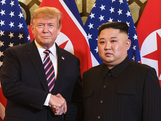 President Donald Trump shakes hands with North Korea's
