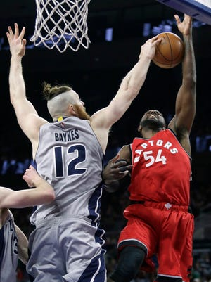 Raptors forward Patrick Patterson has his shot blocked by Pistons center Aron Baynes during the Pistons' 87-75 loss March 17, 2017 at the Palace.