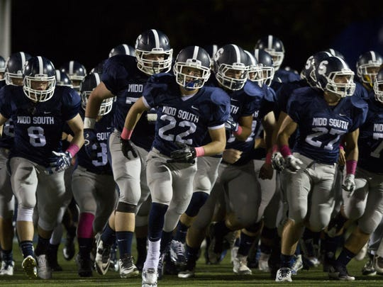 Middletown South, shown entering the field last Friday night for its game against Manalapan, cemented its status as the No. 1 team in the Shore with a 42-7 win over Manalapan.