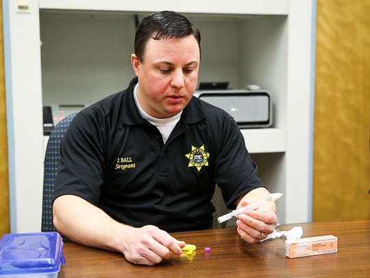 Polk County Sheriff Sgt. Jason Ball demonstrates the