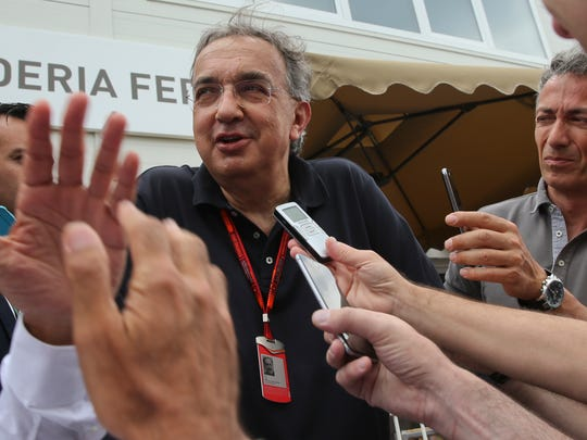 Fiat Chrysler Automobiles Chairman and CEO Sergio Marchionne  answers to reporters prior to the start of the Formula One Grand Prix of Europe at the Baku circuit, in Baku, Azerbaijan, Sunday, June 19, 2016.  (AP Photo/Luca Bruno)