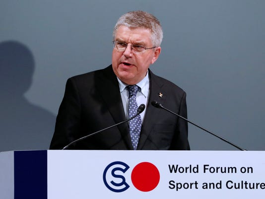 FILE - A Thursday, Oct. 20, 2016 file photo showing International Olympic Committee President Thomas Bach delivering a speech at World Forum on Sports and Culture in Tokyo. Ahead of key campaign speeches to Olympic sports leaders, bid teams from Los Angeles and Paris met Monday with an official audience that could yet sway the 2024 Summer Games hosting race. (AP Photo/Eugene Hoshiko, File)