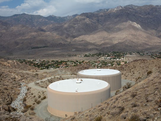 Two large Desert Water Agency water tanks stand overlooking