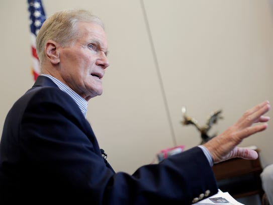 Sen. Bill Nelson talks to local residents in Tampa,