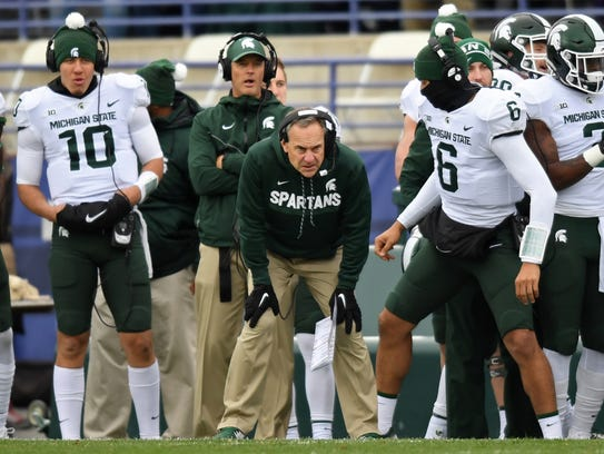 Michigan State Spartans head coach Mark Dantonio looks on from the sidelines during the first half against the Northwestern Wildcats at Ryan Field.