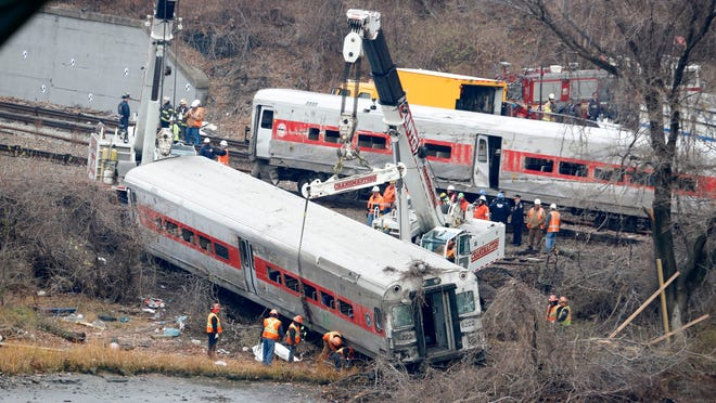 A railroad crew removes the last rail car from the scene of the fatal Metro-North train derailment in December 2013, in the Bronx near the Spuyten Duyvil station.