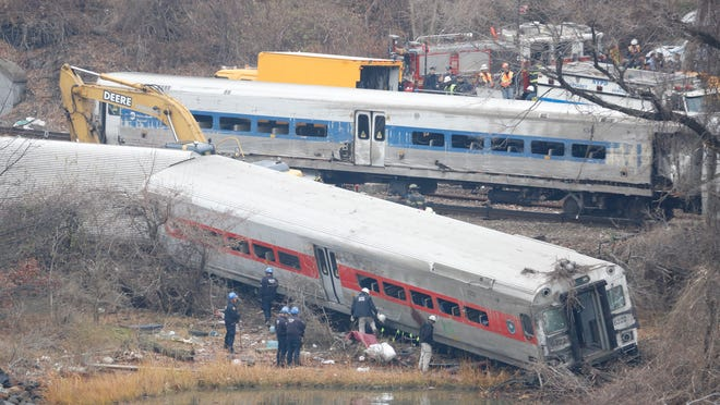 A rail crew works at the scene of the fatal Metro-North train derailment on Dec. 2., 2013, in the Bronx near the Spuyten Duyvil station. The Bronx County District Attorney's office said that the engineer, William Rockefeller, will not face charges in relation to the accident.