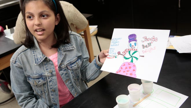 Krista Bertino, 11, a student at the Port Chester Middle School, shows her work during the STEM program.