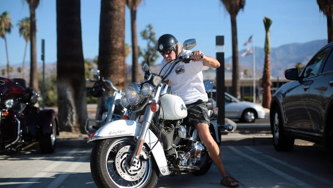 Wynn Seymour of Palm Springs arrives at Palm Springs City Hall to speak out against the cancellation of this year's American Heat Motorcycle Rally.