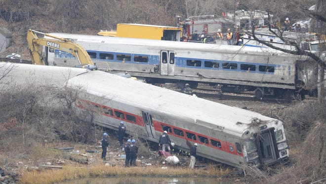 A rail crew works at the scene of the fatal Metro-North train derailment in the Bronx near the Spuyten Duyvil station.