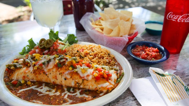 Burrito en Fuego, a Big As Yo' Face Burrito covered in a new spicy Salsa Fuego, is one of five new menu items being introduced as part of Chuy's Green Chili Festival this month.