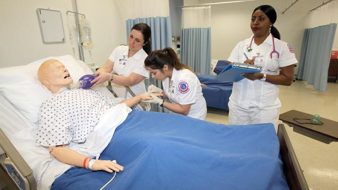 Nursing students work on a mock patient at the College of Central Florida in Ocala in 2013.