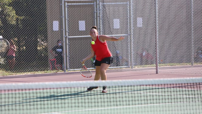 McPherson's Maddie Dobson returns a ball during the Hesston Invitational on Aug. 27th.