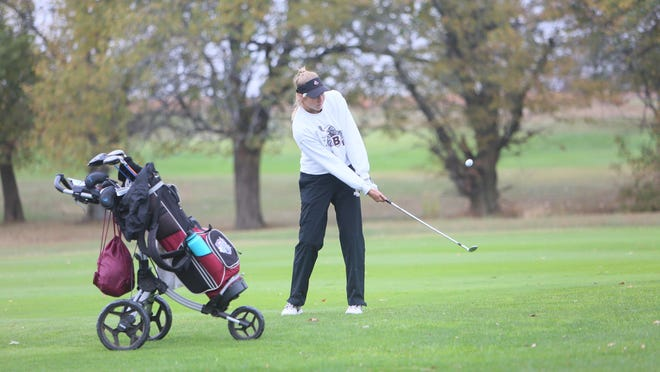 Buhler senior Lauren Specht chips the ball onto the green during the Class 4A state tournament on Tuesday in Emporia. Spect medaled and finished fifth.