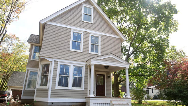 The refurbished home has new windows, siding and roof, although its front profile is essentially the same. There is a new two story addition in the rear of the house along with a two car garage.