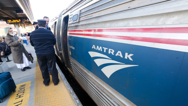 Passengers board an Amtrak train bound for Albany at the Yonkers Metro-North train station. A Bard College student with the measles took the No. 283 Empire line train from Penn Station at 1:20 p.m. Jan. 25.