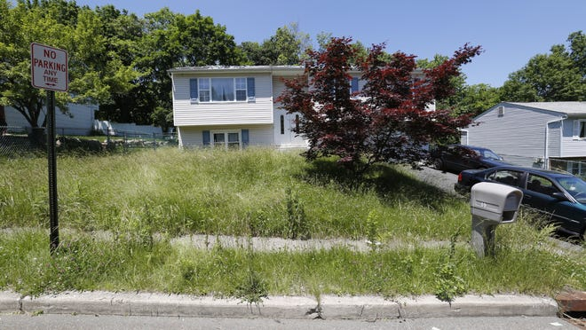 A home at 69 Springbrook Road in Nanuet on June 16, 2014, was in foreclosure and the owners had moved out. The yard was overgrown, the roof in disrepair and one of the windows covered with plywood. Other people were apparently using the driveway.