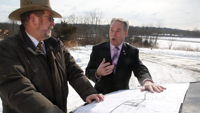 """Rockland County Highway Superintendent Charles """"Skip"""" Vezzetti and Rockland County Executive Ed Day stand on 27 acres of county-owned property in Chestnut Ridge where they hope to build a new Highway Department complex, just off the New York State Thruway Exit 14."""
