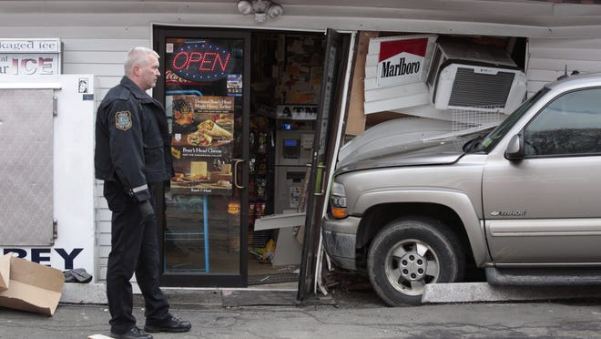 Members of the Stony Point Police and Fire department at the scene of a car crash into the Cove Deli in Tomkins Cove on Mar. 18, 2015.