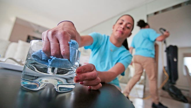 Yasmin Suriel, a house cleaner who works for Merry Maids, cleans a home in New City on March 18, 2015.