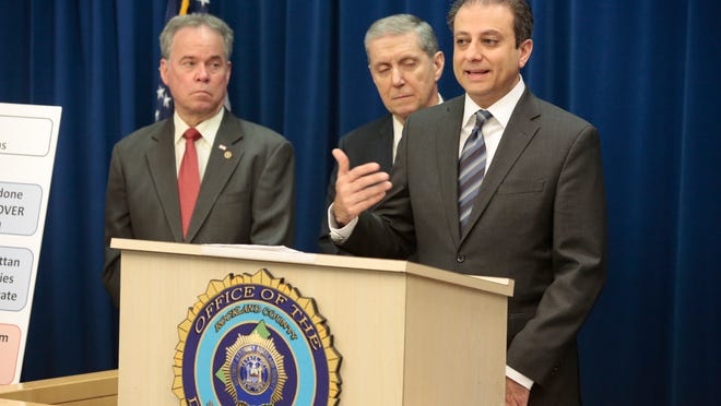 Rockland County Executive Ed Day (left,) Rockland County D.A. Thomas Zugibe and U.S. Attorney Preet Bharara, announce indictment of 29 individuals selling Oxycodone and Heroin at the Rockland District Attorneys Office in New City on March 25, 2015.