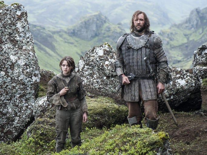 """Game of Thrones"" is nominated for best drama series. Maisie Williams, left, is Arya Stark and Rory McCann is Sandor ""The Hound"" Clegane."