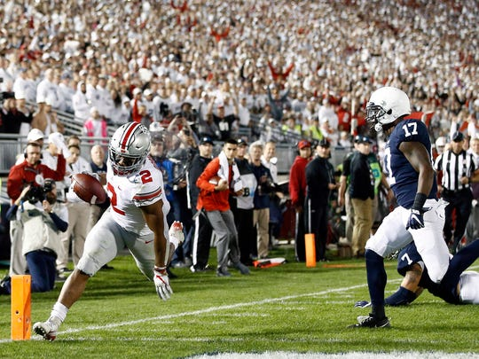 Ohio State's J.K. dobbins (2) runs in for a touchdown against Penn State during the first half of an NCAA college football game in State College, Pa., Saturday, Sept. 29, 2018. (AP Photo/Chris Knight)