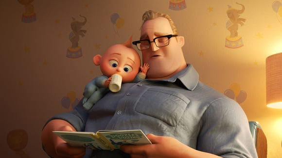 "New stay-at-home dad Bob Parr (voiced by Craig T. Nelson) dozes while reading a bedtime book to baby Jack-Jack in ""Incredibles 2."""